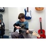 Quais os valores de Aula de guitarra em Santana